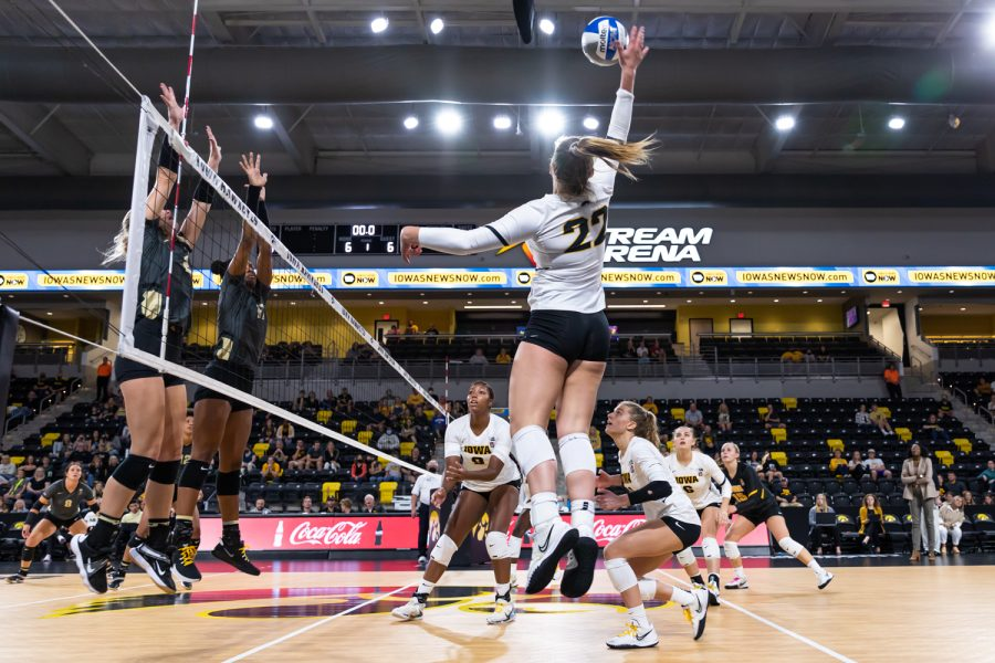 Iowa outside hitter Addie VanderWeide jumps to spike the ball during the volleyball game between Iowa and Purdue at Xtream Arena on Saturday, Oct. 9, 2021. Purdue defeated Iowa 3-0.