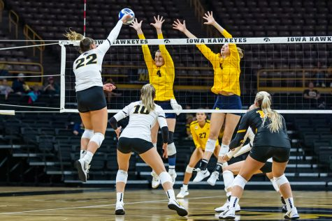 Iowa outside hitter Addie VanderWeide sends the ball over the net during a volleyball game between Iowa and Michigan at Carver-Hawkeye Arena on Saturday, Oct. 2, 2021. Michigan defeated Iowa 3-0.