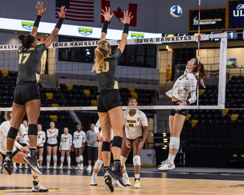 Iowa setter/ rightside hitter Courtney Buzzerio jumps to spike the ball during the volleyball game between Iowa and Purdue at Xtream Arena on Saturday, Oct. 9, 2021. Purdue defeated Iowa 3-0.