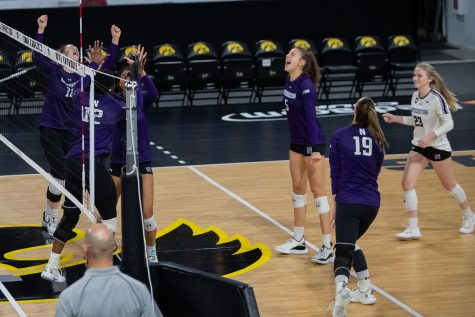 Northwestern celebrates a point scored during a volleyball match at Xtream Arena in Iowa City on Saturday, Oct. 16, 2021. The Wildcats defeated the Hawkeyes 3-0.