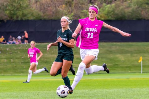 Iowa forward Alyssa Walker goes to kick the ball during a soccer game between Iowa and Michigan State at the Iowa Soccer Complex on Sunday, Oct. 3, 2021. Michigan State defeated Iowa 2-1.