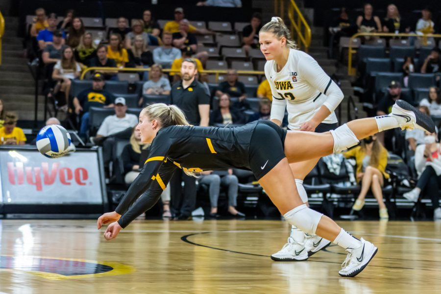 Iowa defensive specialist Maddie Slagle dives to hit the ball during a volleyball game between Iowa and Michigan at Carver-Hawkeye Arena on Saturday, Oct. 2, 2021. Michigan defeated Iowa 3-0.