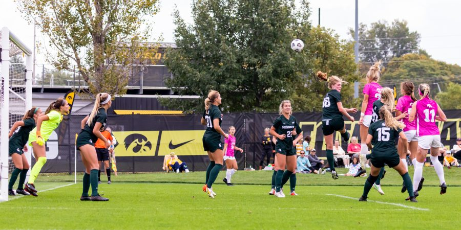 Iowa midfielder Hailey Rydberg heads the ball in an attempt to score during a soccer game between Iowa and Michigan State at the Iowa Soccer Complex on Sunday, Oct. 3, 2021. Michigan State defeated Iowa 2-1.