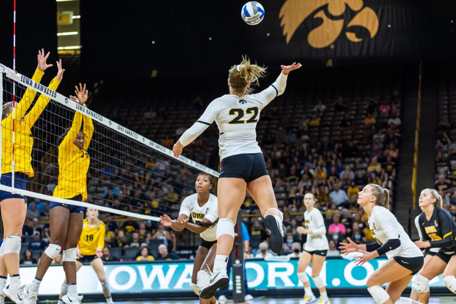 Iowa+outside+hitter+Addie+VanderWeide+jumps+to+hit+the+ball+over+the+net+during+a+volleyball+game+between+Iowa+and+Michigan+at+Carver-Hawkeye+Arena+on+Saturday%2C+Oct.+2%2C+2021.+Michigan+defeated+Iowa+3-0.+
