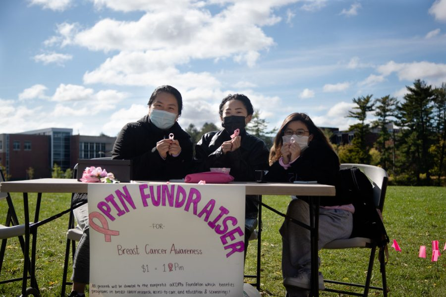 University of Iowa students Janice Jian, Lily Hoang and Paige Ho pose for a photo during a fundraiser for Breast Cancer Awareness at Hubbard Park Monday, Oct. 25, 2021. Alpha Kappa Delta Phi organized the fundraiser with all proceeds going to research.