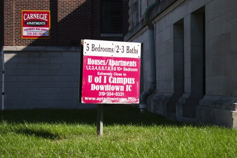 An apartment sign is seen downtown Iowa City on Tuesday, Oct. 19, 2021. (Raquele Decker/The Daily Iowan)