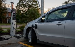 A Chevy Volt is shown being charged at a Hyvee parking lot in Iowa City on Wednesday, Oct. 13, 2021 (Larry Phan/The Daily Iowan)