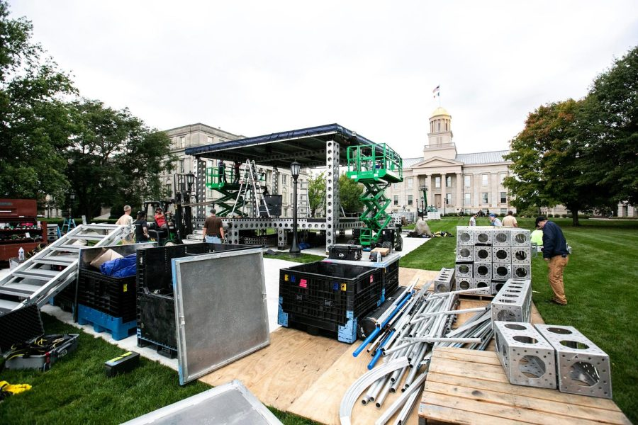 Crews set up the Big Noon Kickoff Fox Sports pregame NCAA football television show set, Tuesday, Oct. 5, 2021, on the east side of the Pentacrest in Iowa City, Iowa. No. 3 Iowa Hawkeyes host No. 4 Penn State this weekend. The pregame show starts broadcasting live at 9 a.m