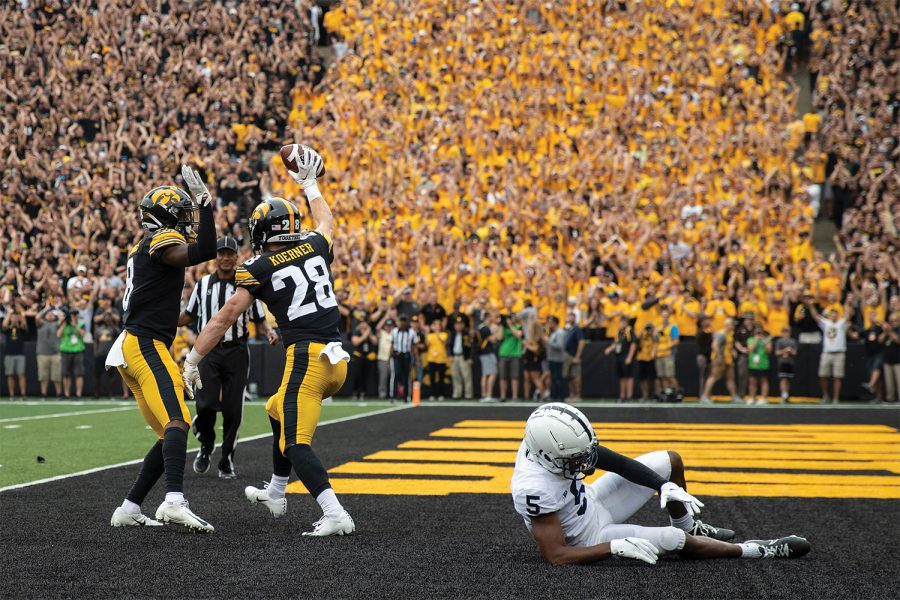 Iowa defensive back Jack Koerner gets up to celebrate with defensive back Matt Hankins during a football game between No. 3 Iowa and No. 4 Penn State at Kinnick Stadium on Saturday, Oct. 9, 2021. The Hawkeyes defeated the Nittany Lions 23-20.