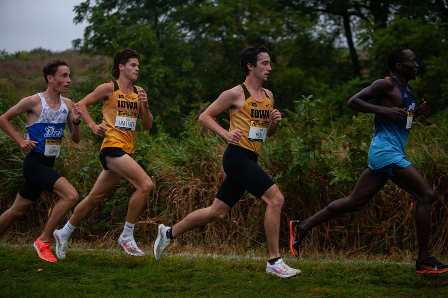 Iowa runners Nick Trattner (left) and Noah Healy (right) compete in the Hawkeye Invite meet at the Ashton Cross Country Course on Friday, Sept. 3, 2021.