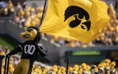 Herky gets the crowd excited before a football game between Iowa and Kent State at Kinnick Stadium on Saturday, Sept. 18, 2021. The Hawkeyes defeated the Golden Flashes with a score of 30-7. (Grace Smith/The Daily Iowan)