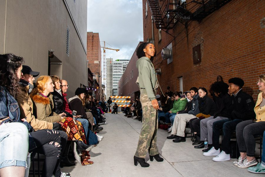 Models walk for the Unique 3 Alley Fashion show behind the Englert Theater during the Witching Hour Festival on Friday, October 12, 2018. The local brand Born Leaders United, created by Andre Wright, debuted their new streetwear line Unseen