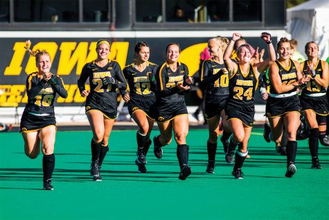Iowa players celebrate the win after the field hockey game between No.1 Iowa and No. 2 Michigan on Friday, Oct. 15, 2021, at Grant Field. The Hawkeyes defeated the Wolverines 2-1 in double overtime and a shootout.(Jeff Sigmund/Daily Iowan)