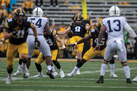 Iowa punter Tory Taylor kicks the ball away during a football game between No. 3 Iowa and No. 4 Penn State at Kinnick Stadium on Saturday, Oct. 9, 2021. The Hawkeyes defeated the Nittany Lions 23-20.