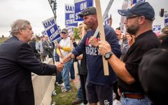 United States Secretary of Agriculture Tom Vilsack visits with picketers on strike outside of Deere & Co., makers of John Deere products, on Wednesday, Oct. 20, 2021, in Ankeny.  1020 Vilsack 012 Jpg