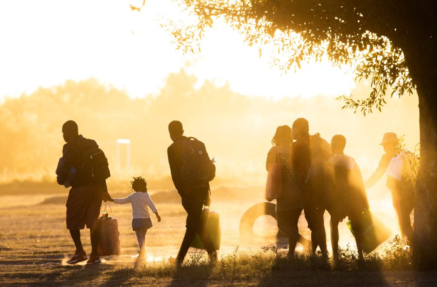 Haitian migrants walk towards the Rio Grande after Mexican police and immigration officers enter the Braulio Fernandez Park where the migrant had taken refuge on Thursday Sept. 23, 2021  Aq2z9120