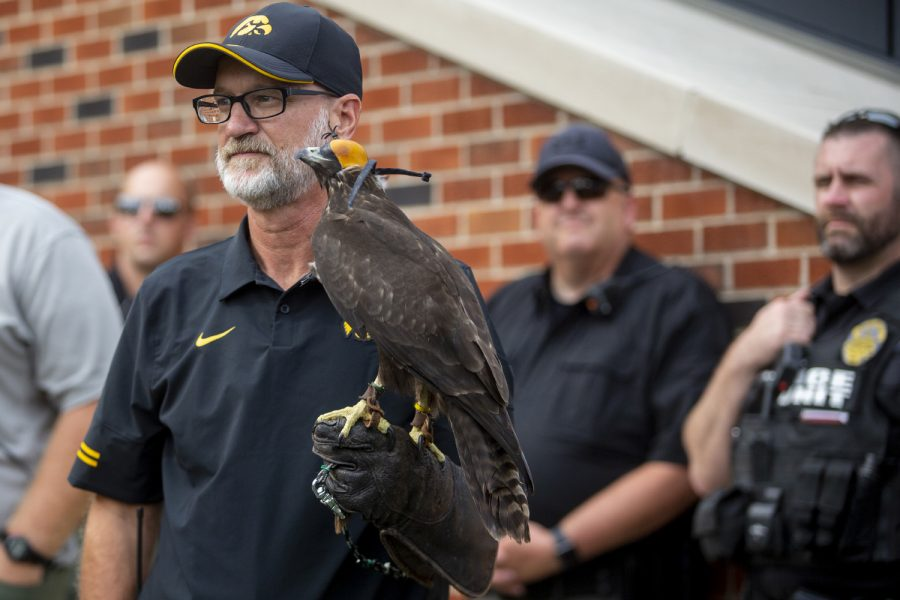 Hercules 2, a female red-tailed hawk, rests on David Conrads' hand before a football game between No. 3 Iowa and No. 4 Penn State at Kinnick Stadium on Saturday, Oct. 9, 2021. The Hawkeyes defeated the Nittany Lions 23-20.