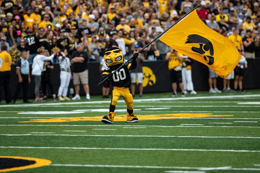 Herky waves a flag before a football game between No. 18 Iowa and No. 17 Indiana at Kinnick Stadium on Saturday, Sept. 4, 2021. The Hawkeyes defeated the Hoosiers 34-6. (Ayrton Breckenridge/The Daily Iowan)