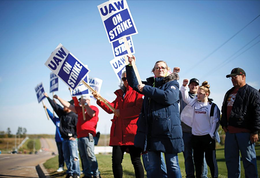 Members of the United Auto Workers strike outside of the John Deere Engine Works plant on Ridgeway Avenue in Waterloo, Iowa, on Friday, Oct. 15, 2021. About 10,000 UAW workers have gone on strike against John Deere since Thursday at plants in Iowa, Illinois and Kansas.