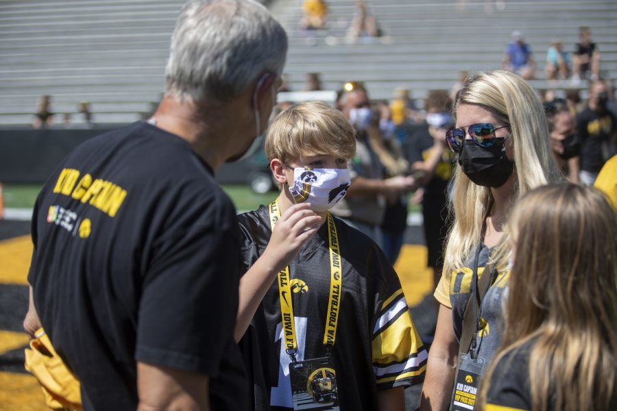 "Iowa kid captain Ayden Gendreau and family speak with head coach Kirk Ferentz during ""Kid's Day at Kinnick"" inside Kinnick Stadium on Saturday, Aug. 14. (Jerod Ringwald/The Daily Iowan)"