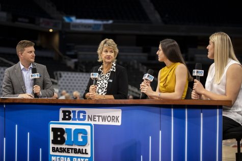 Iowa women's head basketball coach Lisa Bluder speaks with Big Ten Network broadcaster Mike Hall and players Caitlin Clark and Monika Czinano during Big Ten Basketball Media Days at Gainbridge Fieldhouse in Indianapolis, Indiana on Thursday, Oct. 7, 2021.