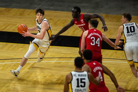 Iowa Forward Patrick McCaffery (22) moves the ball during an Iowa men's basketball game against Nebraska on Thursday, March 4, 2021 at Carver-Hawkeye arena. The Hawks beat the Cornhuskers, 102-64. (Kate Heston/The Daily Iowan)