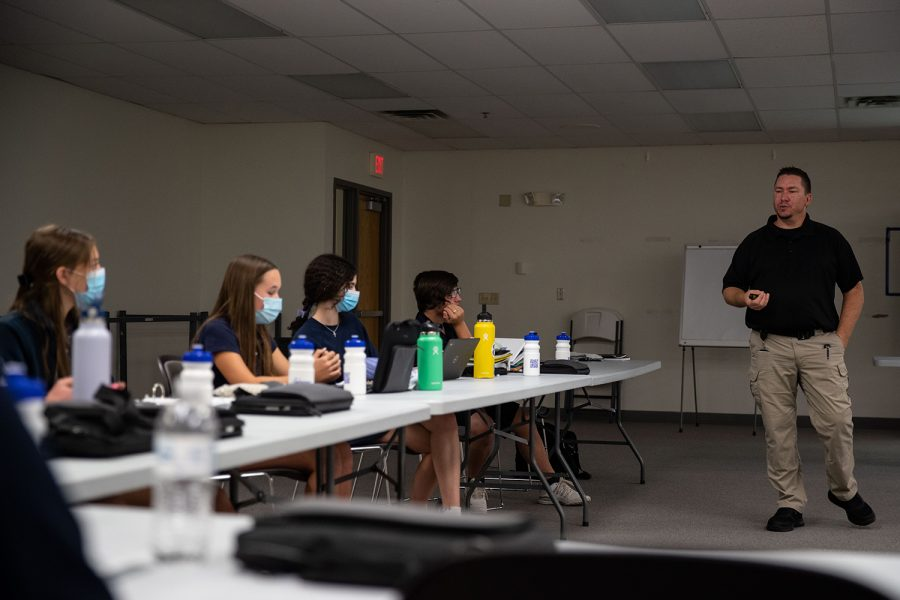 Johnson County Deputy Director of Emergency Management Agency Travis Beckman speaks during a Community Emergency Response Team (CERT) class at Regina Catholic Education Center on Thursday, Sept. 30, 2021. The class is one of the first in Iowa and hopes to develop leadership and first responder skills for high schoolers.