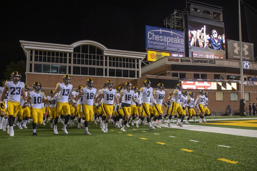 The Iowa football team enters the field during a football game between Iowa and Maryland at Maryland Stadium on Friday, Oct. 1, 2021. The Hawkeyes defeated the Terrapins 51-14.