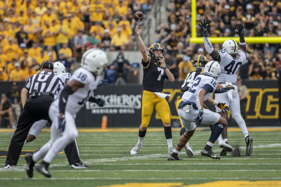 Iowa+quarterback+Spencer+Petras+passes+the+ball+during+a+football+game+between+No.+3+Iowa+and+No.+4+Penn+State+at+Kinnick+Stadium+on+Saturday%2C+Oct.+9%2C+2021.+The+Hawkeyes+defeated+the+Nittany+Lions+23-20.