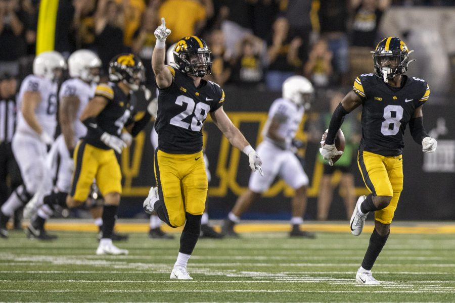 Iowa+defensive+back+Matt+Hankins+runs+with+the+football+after+intercepting+a+pass+alongside+defensive+back+Jack+Koerner+during+a+football+game+between+No.+3+Iowa+and+No.+4+Penn+State+at+Kinnick+Stadium+on+Saturday%2C+Oct.+9%2C+2021.+The+Hawkeyes+defeated+the+Nittany+Lions+23-20.