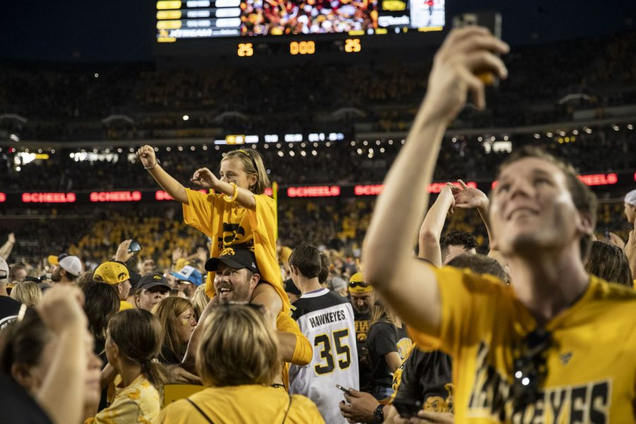 Iowa fans storm the field after a football game between No. 3 Iowa and No. 4 Penn State at Kinnick Stadium on Saturday, Oct. 9, 2021. The Hawkeyes defeated the Nittany Lions 23-20.