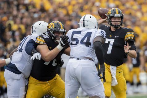 Iowa quarterback Spencer Petras looks to pass during a football game between No. 3 Iowa and No. 4 Penn State at Kinnick Stadium on Saturday, Oct. 9, 2021. The Hawkeyes defeated the Nittany Lions 23-20. (Grace Smith/The Daily Iowan)