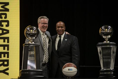 Iowa men's head basketball coach Fran McCaffery takes a photo with Big Ten Conference Commissioner Kevin Warren during Big Ten Basketball Media Days at Gainbridge Fieldhouse in Indianapolis, Indiana on Thursday, Oct. 7, 2021.